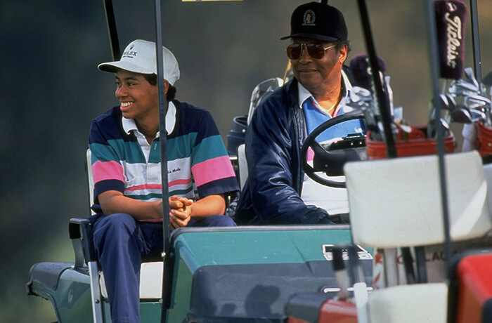 Young Tiger Woods with his Father Earl Woods rare image