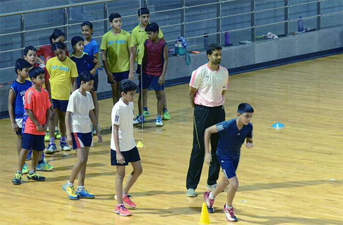 Pullela Gopichand at Gopichand Badminton Academy training children