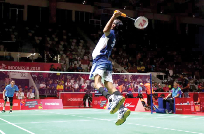 Para Badminton player Shuttler Pramod Bhagat playing badminton