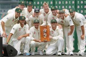 Australian team pose with the Warne-Muralitharan trophy