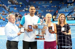 Nick Kyrgios (2nd L) and Daria Gavrilova (2nd R) of Australia pose with the trophy after winning the Hopman Cup