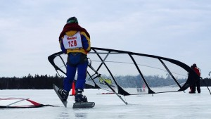 Ice sailing athlete preparing his sail