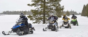 Snowmobiling riders