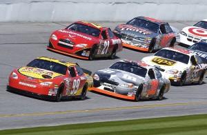 NASCAR vehicles practicing at Daytona International Speedway in 2004