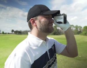 Golfer estimating the distance with Golf Rangefinder