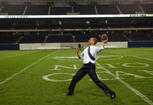 Former President Barack Obama throws a football at Soldier Field after the 2012 NATO summit